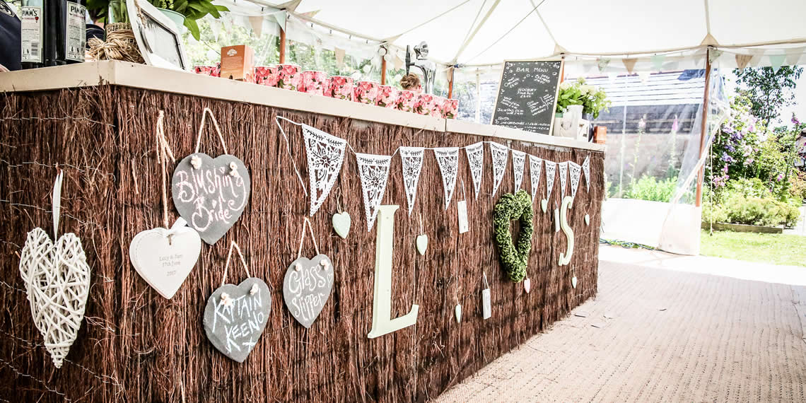 A Marquee Bar In Our Secret Garden Wedding Venue